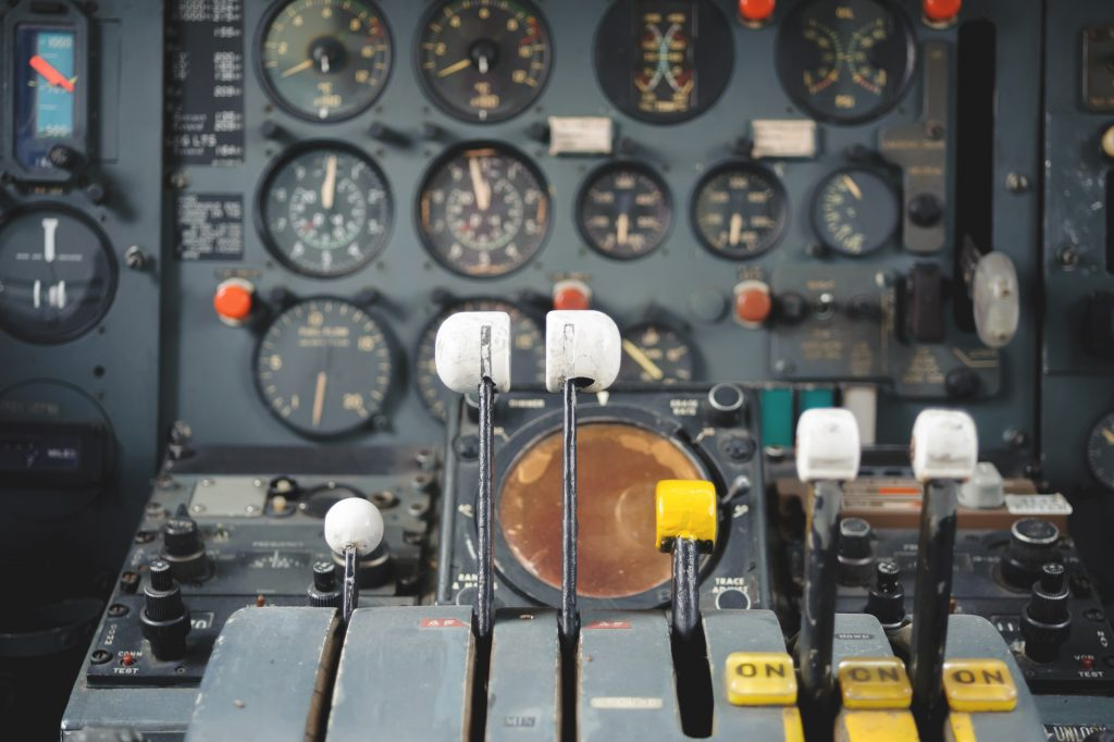 Airplane Cockpit Equipment with indicators, buttons, and instruments.